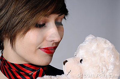 Grateful girl with teddy bear