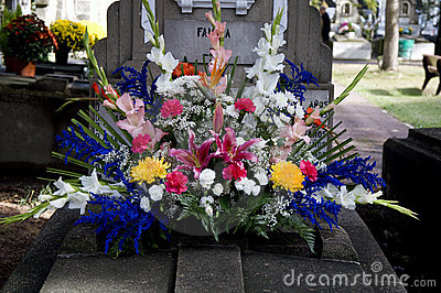 Grave with colorful flowers decoration