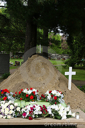 Grave with flowers and cross
