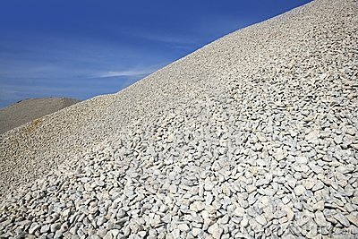 Gravel gray mound quarry stock blue sky