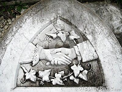 Gravestone: farewell handshake