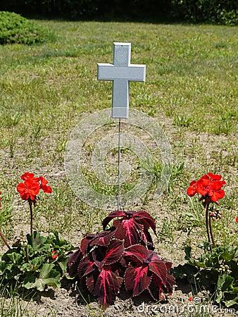 Gravestone: floating white cross