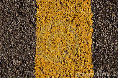 Gray, black and yellow asphalt background