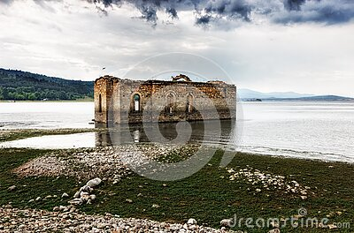 Gray And Brown Building On Body Of Water Under Cloudy Sky During Daytime Free Public Domain Cc0 Image
