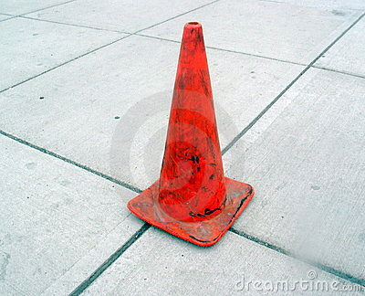 Gray Sidewalk and Orange Cone