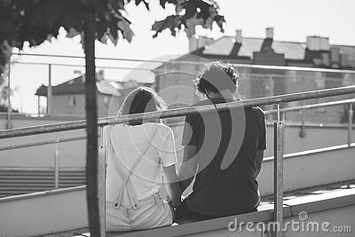 Grayscale Photo Of Man And Woman Sitting On Inclined Road Free Public Domain Cc0 Image