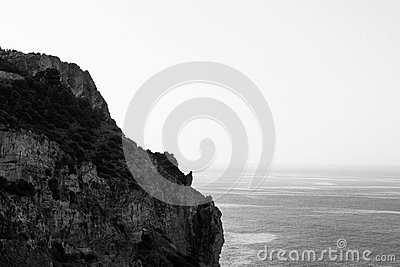 Grayscale Photo Of Rocky Cliff By The Sea At Daytime Free Public Domain Cc0 Image