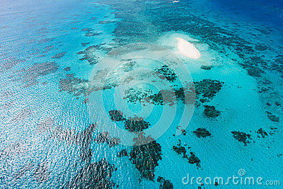 Great Barrier Reef and coral sand cay from above