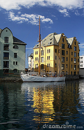 Great boat and house reflected - Alesund, Norway