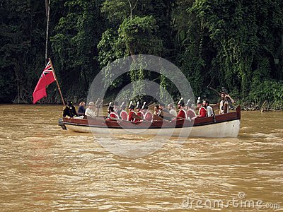 Great Britain marines in boat at muddy river Editorial Stock Image