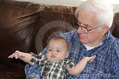 Great-grandpa holding baby