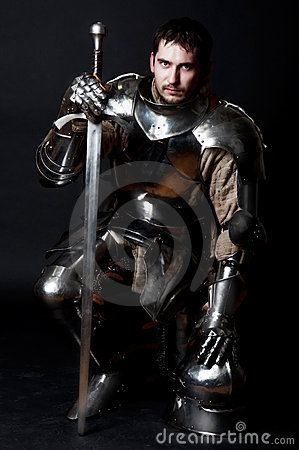 Free Great Knight Holding His Sword And Helmet Stock Image - 11977831