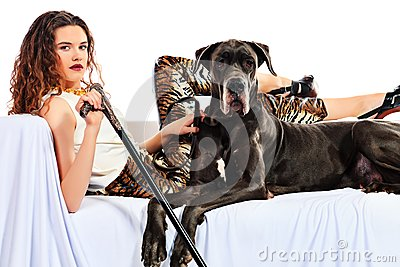 Beautiful young woman posing with her Great Dane dog. Isolated over