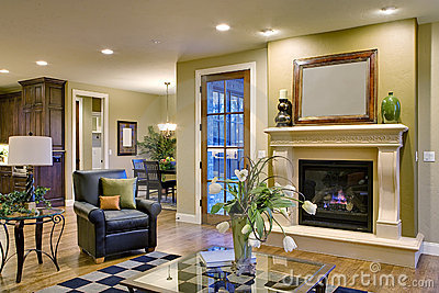 Great room with fireplace and view of kitchen