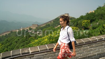 Great Wall China travel- Woman walking on the famous tourist attraction. Great Wall China travel. Tourist woman in Asia walking on famous Chinese tourist stock video footage