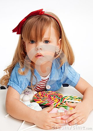 Free Greedy  Girl With Pile Of Sweets Royalty Free Stock Images - 24893239