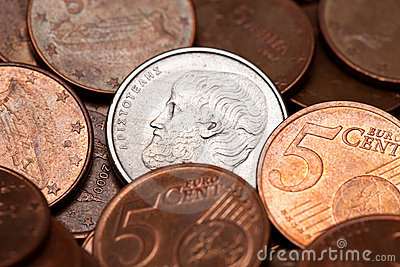 Greek 5 drachmas coin among euro coins