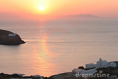 Greek coast with old church at sunrise