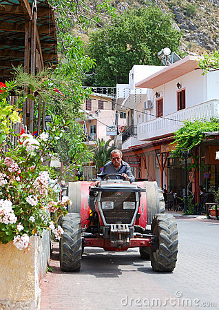 Greek farmer drives his tractor Editorial Stock Photo