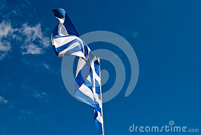 Blue and white Greek flag against blue sky, holida