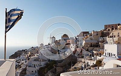 Greek flag in Oia village at Santorini island