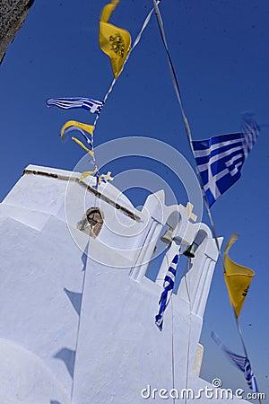 Greek flags flying on church