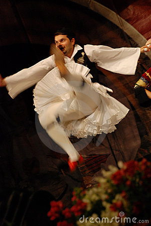 Greek folk dancer jumping on stage Editorial Photography