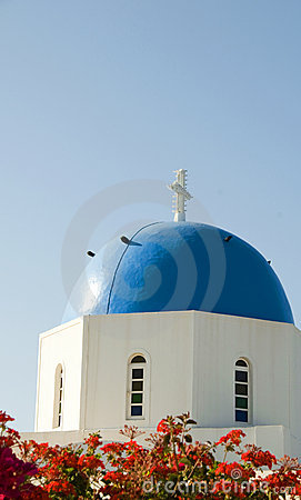 Greek island blue dome church with flowers