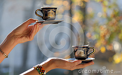Hands serving coffee