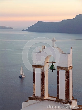 Free Greek Orthodox Church Bell Tower Against Aegean Sea With Sailing Boat At The Sunset, Santorini Royalty Free Stock Photo - 91542815