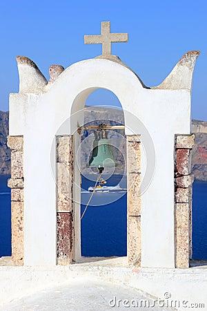 Greek orthodox church with Ferry boat in Santorini