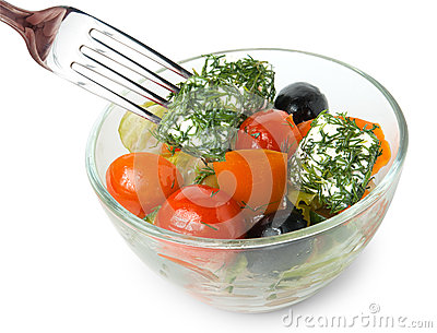 Greek salad in bowl and fork