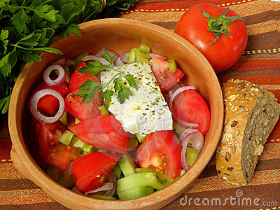 Greek salad on a striped tablecloth