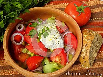 Greek salad on a striped tablecloth
