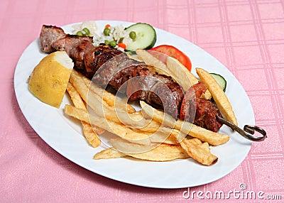 Greek taverna pork souvlaki skewer