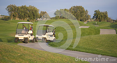 Town Golf Course Carts on Path Evening Sunset
