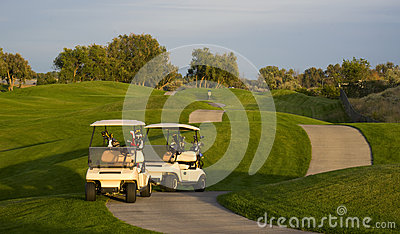 Two Carts Parked on Pathway Manicured Golf Course