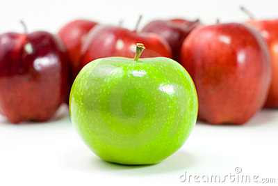 A Green Apple and a Bunch of Red Apples