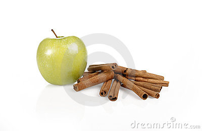 Green apple with cinnamon sticks