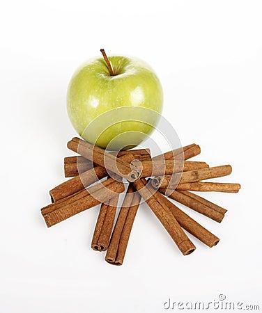 Green apple and cinnamon sticks