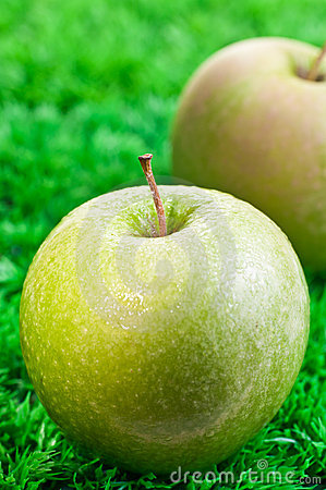 Green apple close up with apple at background