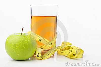 Green apple and juice with measuring tape