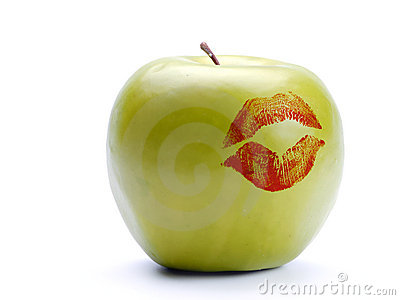 Green apple with lipstick print