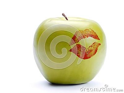 Green apple with lipstick print