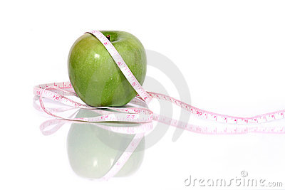 Green apple and measurment tape