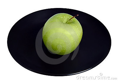 Green apple on a plate