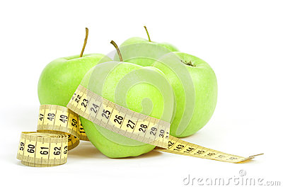 Green apples and measuring tape isolated on white background