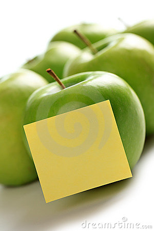 Green apples and notepaper