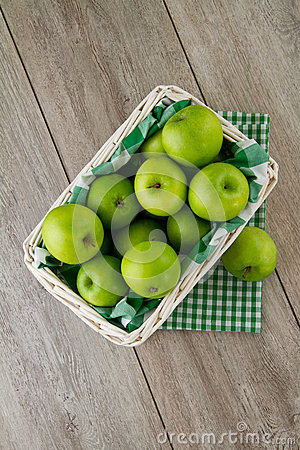 Green apples in white basket