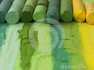 Green artistic crayons in the line